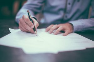 lawyer making changes to estate planning documents after divorce