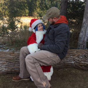Schloemer Law attorney with son in Santa hat