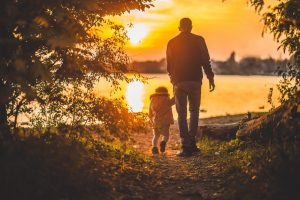 retired gentleman walking with grandchild after estate planning