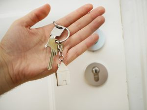 homeowner with new key after smooth legal home sale