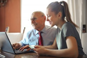 business owner making business decisions with family member as part of business succession plan
