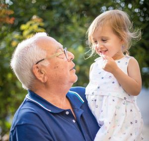 grandparent with granddaughter planning for retirement